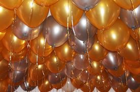 gold and silver balloons turn up